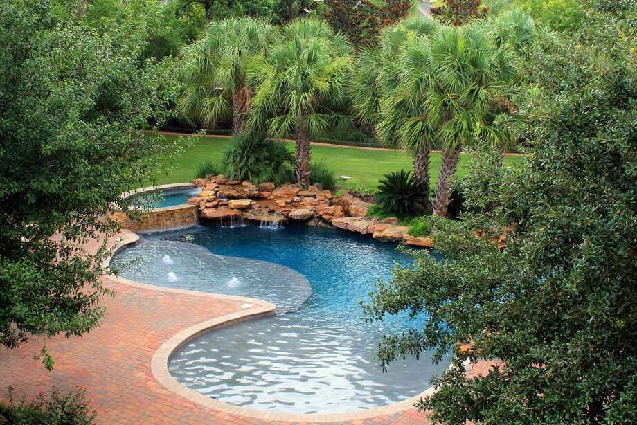The resort-style pool is surrounded by gorgeous landscaping. Photo: RealEstate.MarthaTurner.com