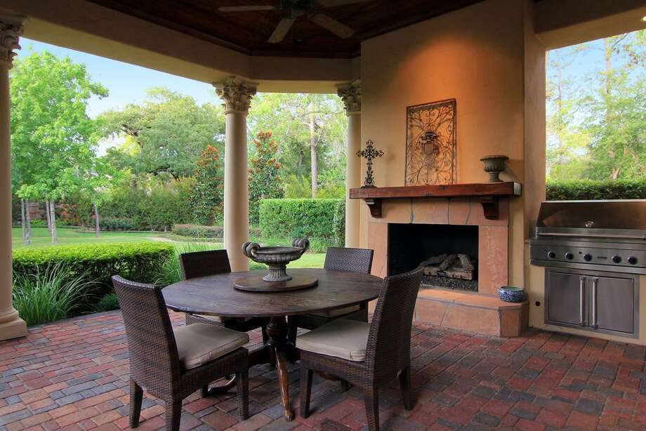 The summer kitchen offers outdoor cooking as an option, along with a fireplace for those cool nights. Photo: RealEstate.MarthaTurner.com