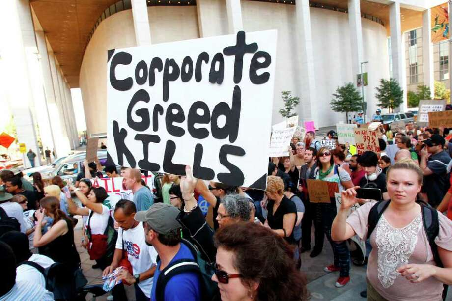 Occupy Houston, an outgrowth of the Occupy Wall Street protests in New York,  protest in front of the JPMorgan Chase Tower in downtown Houston Thursday, October 6, 2011 to denounce what they describe as social and economic equality and corporate greed. Photo: Michael Paulsen , Houston Chronicle  / Houston Chronicle
