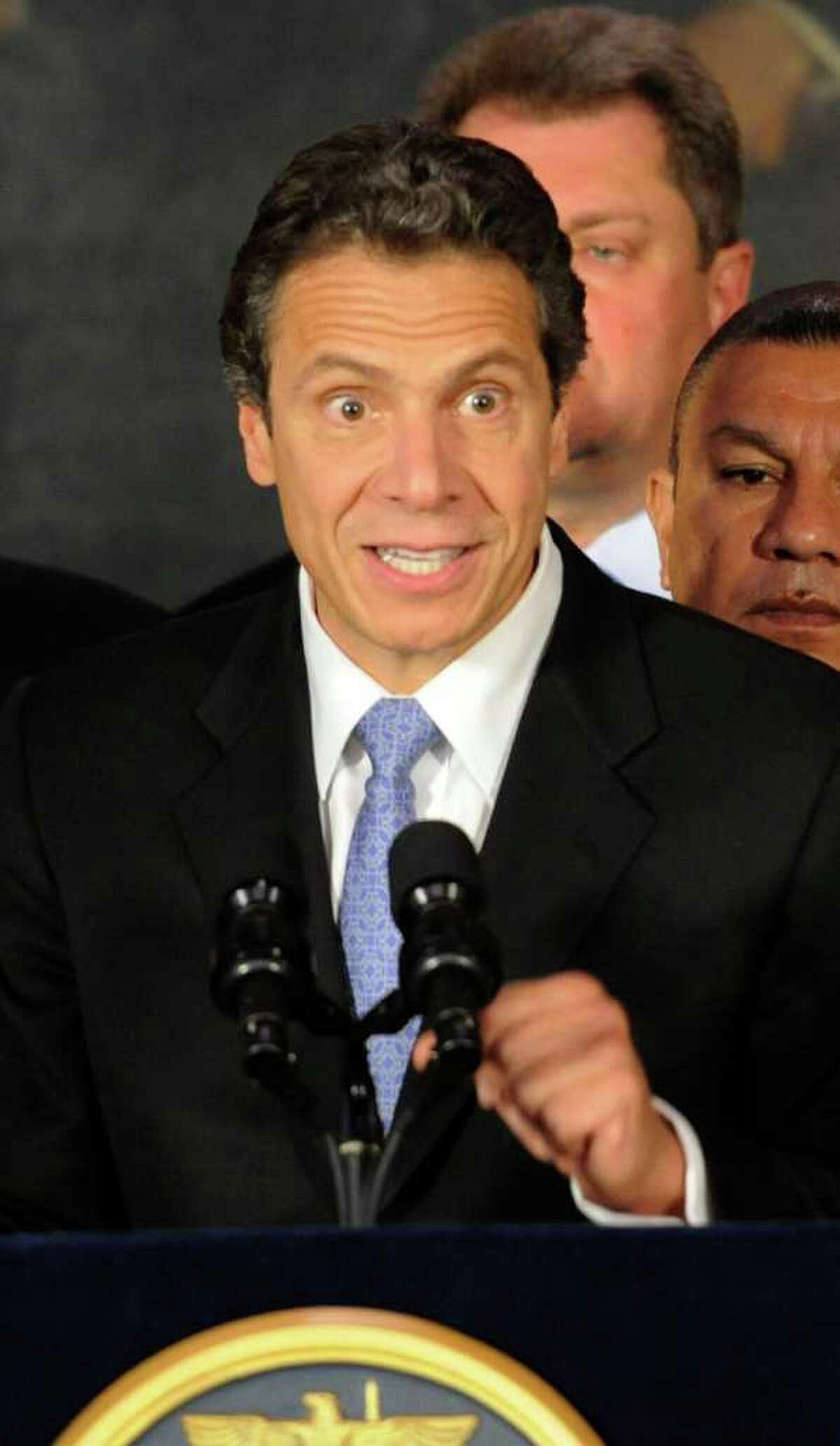 Governor Andrew Cuomo is animated in his response to questions by the media on various subjects after signing an Executive Order that will ensure that state government services are accessible to all regardless of English language ability. (Skip Dickstein / Times Union)