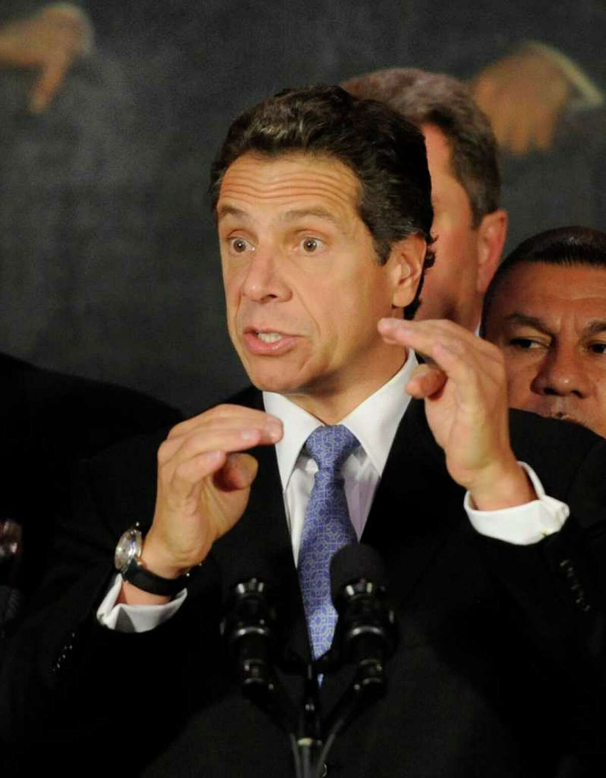 Governor Andrew Cuomo is animated in his response to questions by the media on various subjects after signing an Executive Order in the Red Room of the Capital in Albany, N.Y. October 6, 2011, that will ensure that state government services are accessible to all regardless of English language ability. (Skip Dickstein / Times Union)