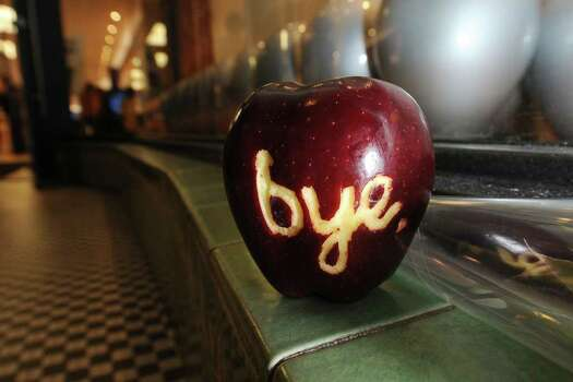 "An apple with the word ""bye"" carved into it sits outside an Apple store after it was left by a man commemorating the life of Apple Inc's founder and former chief executive Steve Jobs, October 5, 2011 in Pasadena, California. Photo: ROBYN BECK, Getty / AFP"