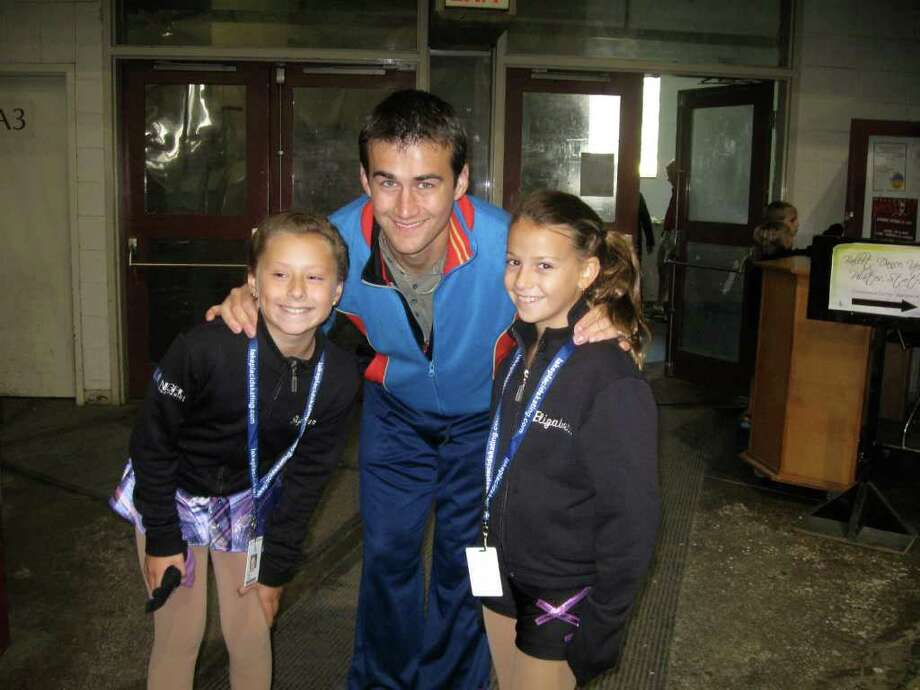 Members of the Mohowk Figure Skating Club, Elizabeth Bernardini, left, and Skylar Dailey, participated in a skating clinic with Ryan Bradley, the 2011 United States men?s figure skating champion.