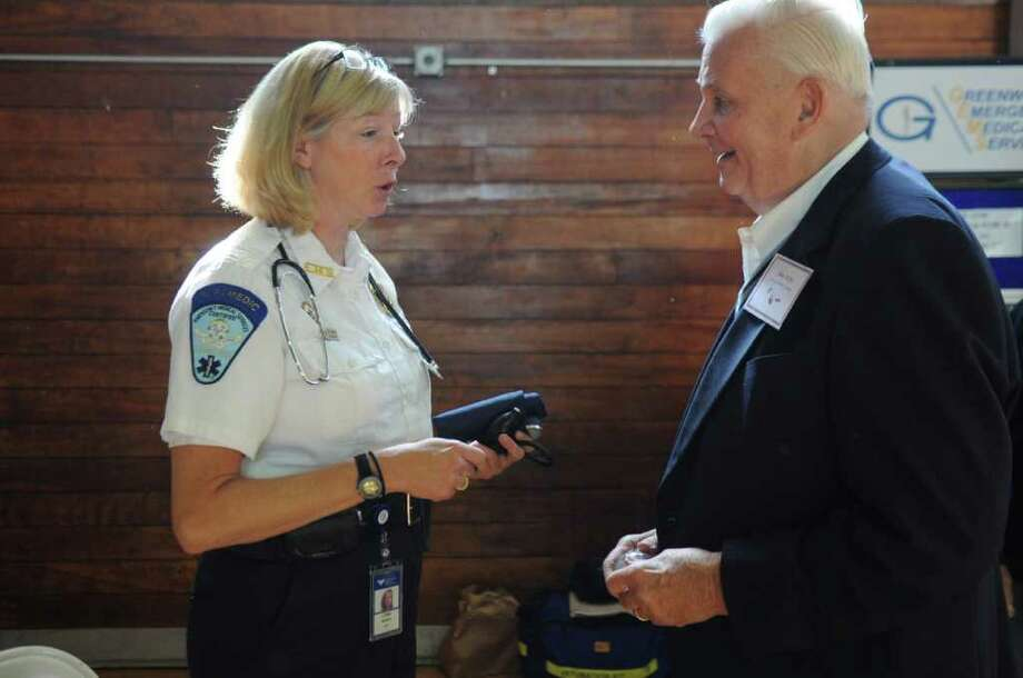 Lynne Ridberg of Greenwich Emergency Medical Services speaks with John Rupp at the 17th annual Senior Health Fair at the Eastern Greenwich Civic Center Thursday, Oct. 6, 2011. Photo: Helen Neafsey / Greenwich Time