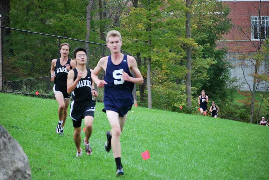 Staples' Patrick Nolan enjoys his lead on two Fairfield Warde runners Tuesday at a quad-meet in Ridgefield. Nolan passed two Warde runners and placed fourth in catapulting the Wreckers to a quad-meet sweep. Photo: Megan Smith / Contributed Photo