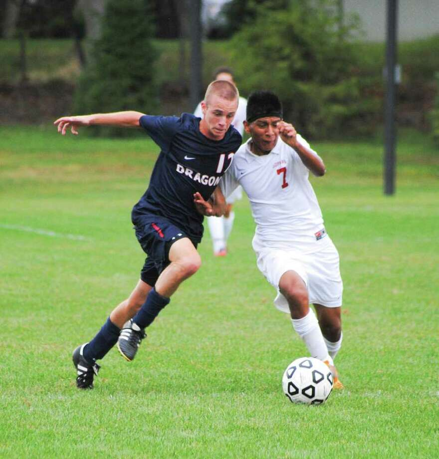 Greens Farms Academy's Spencer Hartig, left, scored a hat trick in GFA's 7-4 victory over Masters. Photo: Contributed Photo