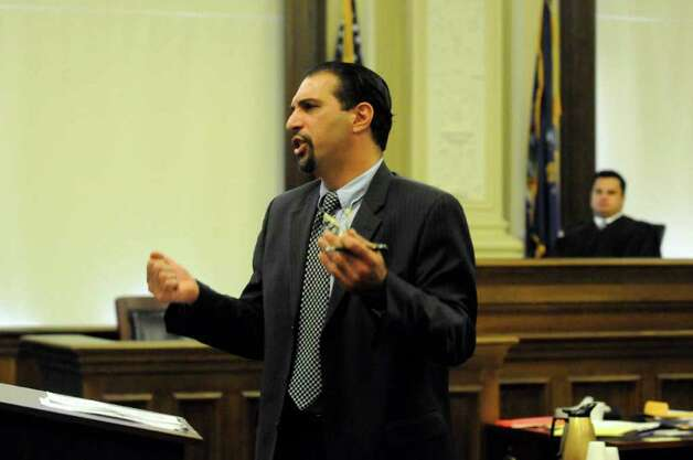 Defense attorney Gregory Cholakis makes his closing argument during  Joseph McElheny's murder trial at the Rensselaer County Courthouse in Troy, N.Y. Thursday Oct. 6, 2011.The Hoosick Falls man is accused of killing his 4-month-old daughter.( Michael P. Farrell/Times Union) Photo: Michael P. Farrell