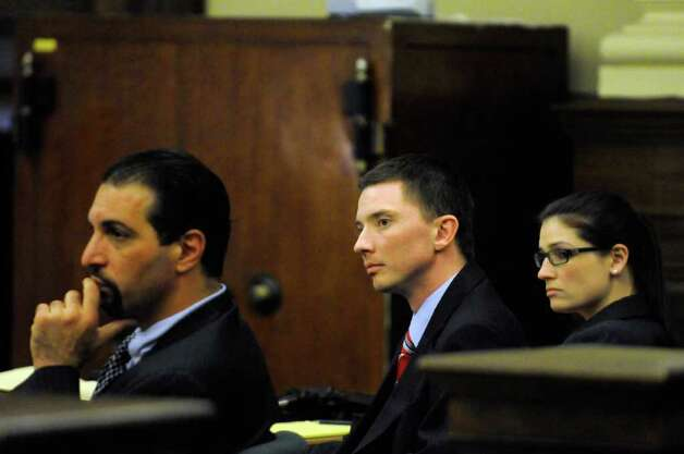 Joseph McElheny,center, sits with his defense as prosecution attorney Christa Book delivers her closing argument during his murder trial at the Rensselaer County Courthouse in Troy, N.Y. Thursday Oct. 6, 2011.The Hoosick Falls man is accused of killing his 4-month-old daughter.( Michael P. Farrell/Times Union) Photo: Michael P. Farrell