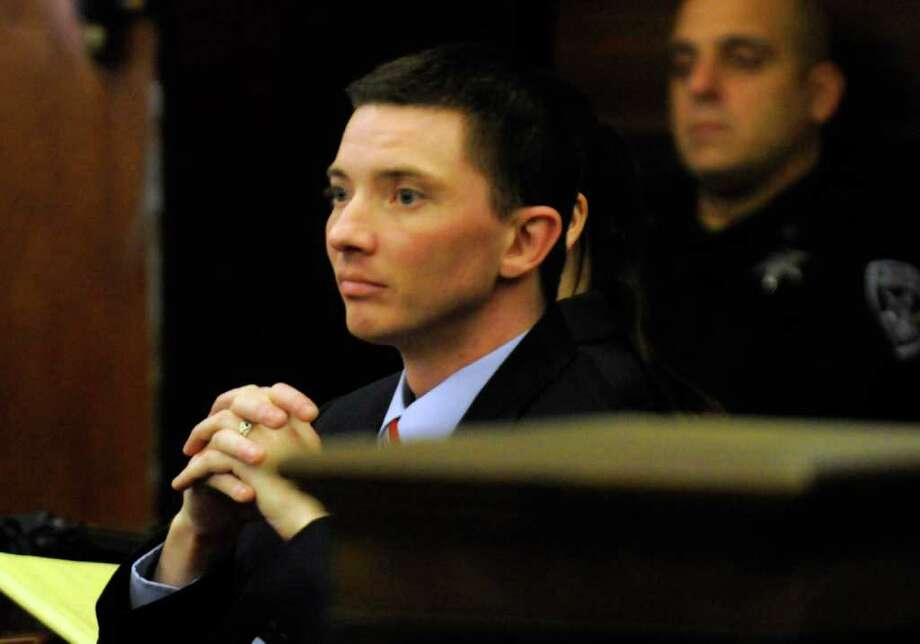Joseph McElheny listens as his  attorney Gregory Cholakis makes his closing argument during his murder trial at the Rensselaer County Courthouse in Troy, N.Y. Thursday Oct. 6, 2011.( Michael P. Farrell/Times Union) Photo: Michael P. Farrell