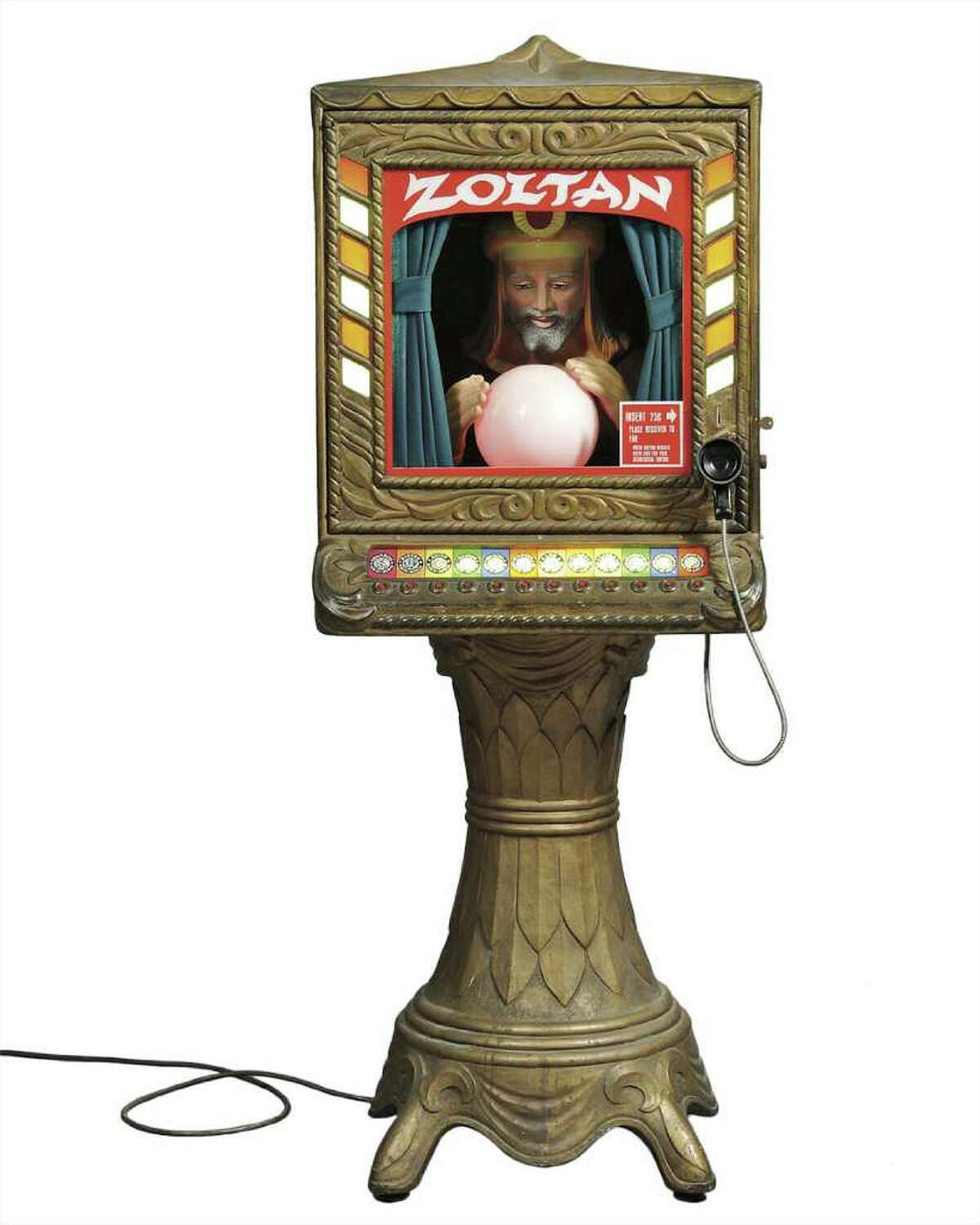 This is Zoltan, the coin-operated fortune teller made of fiberglass by Prophetron, Inc., in the early 1970s. The fortune was spoken by a voice thatís heard through an earpiece. Skinner, Inc., of Marlborough, Mass., auctioned it for $3,500. (Photo courtesy of Skinner, Inc.)