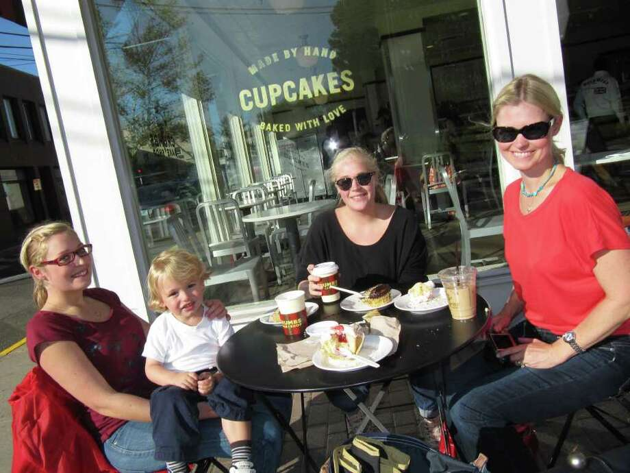 Enjoying some cupcakes on the sidewalk in front of Crumbs, 40-44 Post Road E., are Maria Nilson, two-and-a-half-year-old Matias Croteau, Frida Nilson, and Easton resident Lena Croteau. Photo: Kirk Lang / Westport News contributed