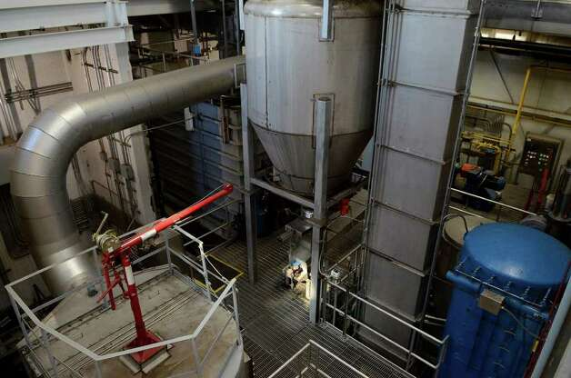 Machinery processes solid wastes from Stamford's waste water into pellets at Stamford's Water Pollution Control Authority (WPCA) facility on Harbor View Ave. on Oct. 6, 2011. The machines evaporate remaining water from the solid waste, making it less costly to transport offsite, and apply heat to kill pathogenic bacteria. Pellets are then shipped to farms in upstate New York as fertilizer and also to another plant to use as fuel. Photo: Shelley Cryan / Shelley Cryan freelance; Stamford Advocate freelance