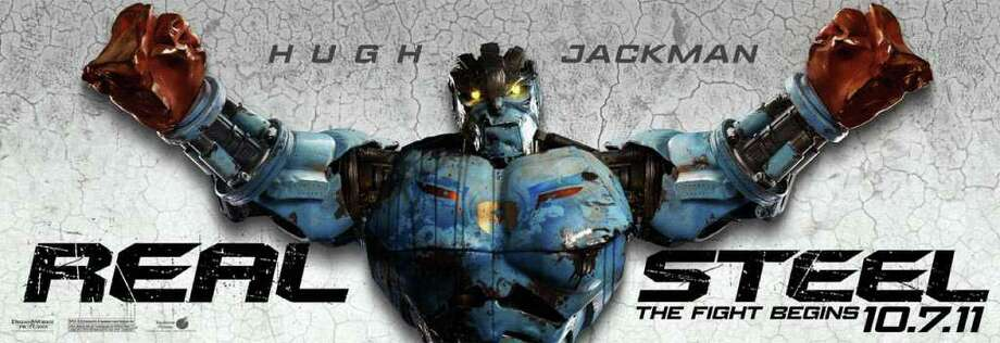 DISNEY PICTURES ROBOTIC ROCKY: Robots are programmed to battle it out in the ring in Real Steel.