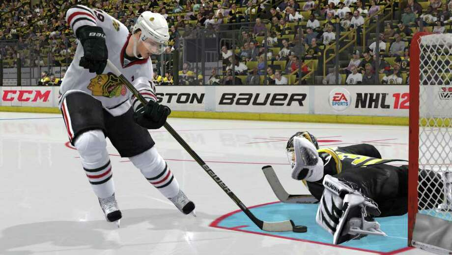 """In this video game image released by EA Sports, the Chicago Blackhawks battle the Boston Bruins in EA Sports' """"NHL 12."""" (AP Photo/EA Sports)"""