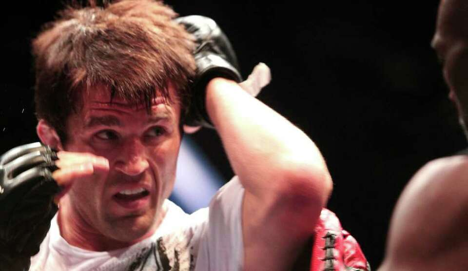 Chael Sonnen spars at the center of the octagon during workouts for UFC 136 at George R. Brown Cente