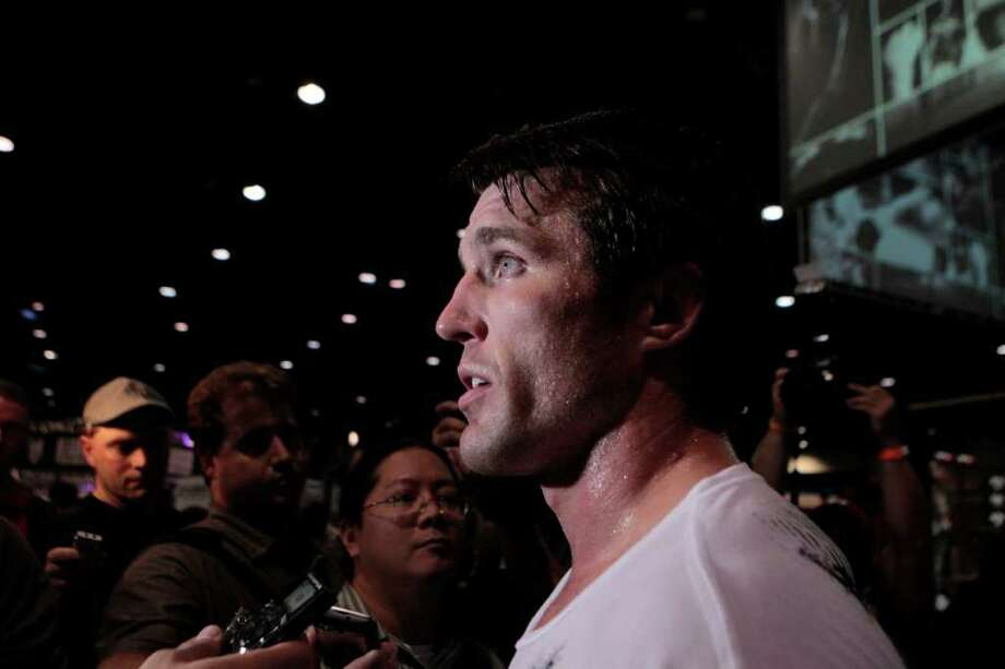 Chael Sonnen speaks with the media after workouts for UFC 136 at George R. Brown Center, Thursday, October 6, 2011.  Chael Sonnen will match-up with Brian Stann Saturday, October 8, 2011 at Toyota Center  in UFC 136. Photo: Billy Smith II, Chronicle / 2011 Chronicle