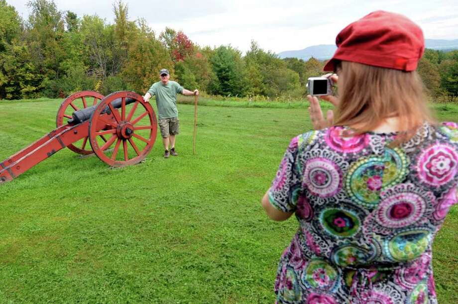 Kerry Norton of Charlotte, N.C. poses for a picture as his wife, Debbie, snaps the shot on Wednesday, Sept. 28, 2011, at Saratoga National Historical Park in Stillwater, N.Y. The couple, who are Glens Falls natives, said they return once a year to visit the area. (Cindy Schultz / Times Union) Photo: Cindy Schultz