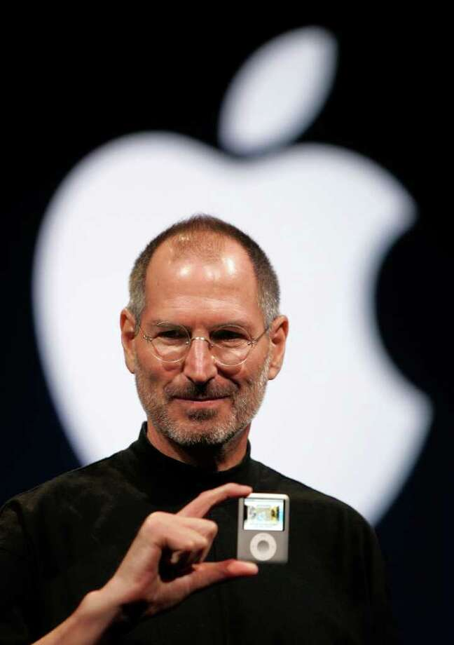 ASSOCIATED PRESS MAGICIAN: Steve Jobs was nothing if not cinematic. He projected his own image onto giant screens as he rolled out product after product like some microchip Merlin. Photo: Paul Sakuma / AP2007
