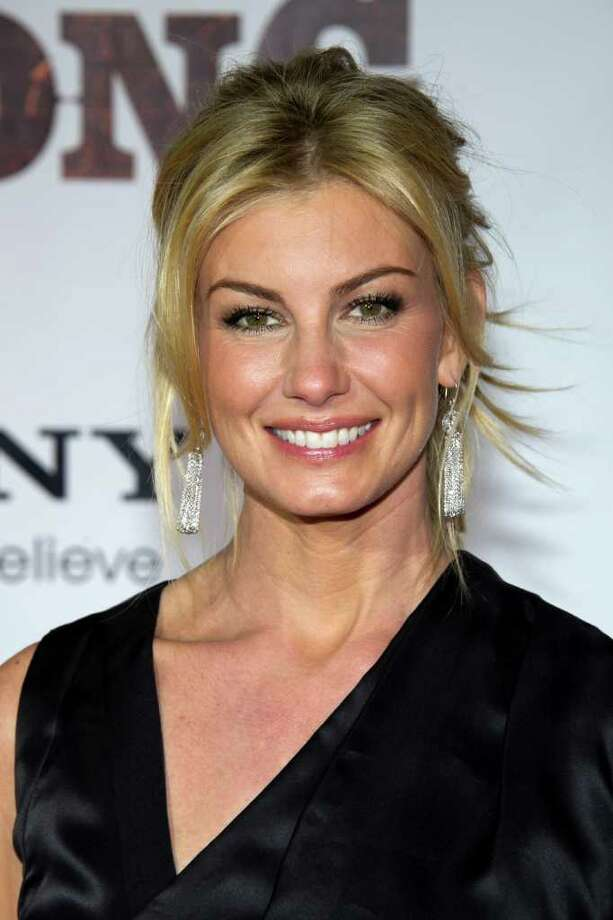 "FILE - In this Nov. 8, 2010 file photo, singer Faith Hill attends the ""Country Strong"" premiere in Nashville, Tenn. Hill will debut a new song on next month's Country Music Association Awards. The show airs Nov. 9 on ABC from Nashville. (AP Photo/Charles Sykes) Photo: Charles Sykes"