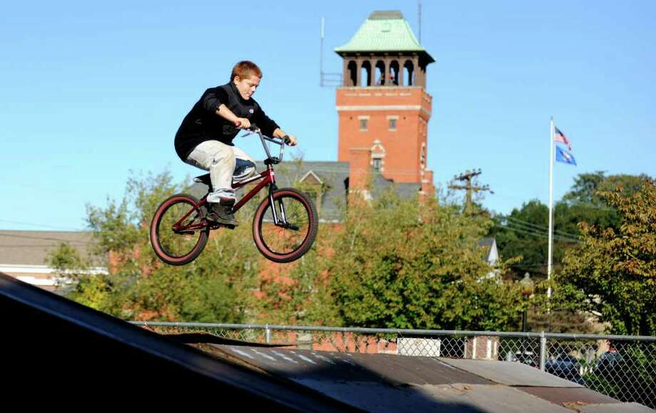 Twelve-year-old Noah Watson rides his bike at the Seymour Skate Park in downtown Seymour, Conn. Thursday, Oct. 6, 2011.  Noah and his friends ride bmx bikes and love to use the town's skate park, which is closed.  Watson attended the selectmen meeting asking selectmen to reopen the park. Photo: Autumn Driscoll / Connecticut Post