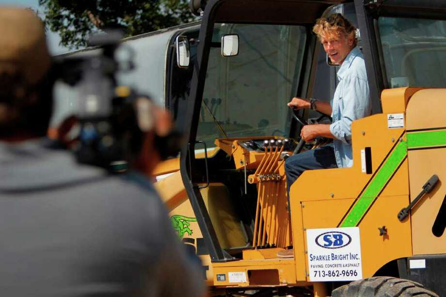 MAKING THE GRADER: Schneider learns about tractors, cement mixers, steamrollers and other heavy equipment on Trick My What? The show overhauls the vehicles for Texans whose livelihood depends on them. Photo: Mayra Beltran / © 2011 Houston Chronicle