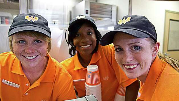 Whataburger employees smile for the camera in one of the new documentary commercials set to air on television starting next week. Photo: PHOTO COURTESY WHATABURGER / Photo courtesy of WHATABURGER