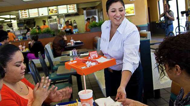 "The new Whataburger television ads were shot in the style of a documentary and feature interviews with customers and employees. Viewers probably will notice that they no longer feature a twangy, downhome male announcer proclaiming, ""Just like you like it."" Photo: PHOTO COURTESY WHATABURGER / Photo courtesy of WHATABURGER"