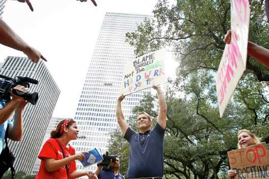 Justin Conry (second from right) an anti-protestor is confronted by protestors with the Occupy Houston movement, an outgrowth of the Occupy Wall Street protests in New York, gather at City Hall in downtown Houston to denounce what they describe as social and economic equality and corporate greed, Thursday, Oct. 6, 2011, in Houston. Photo: Michael Paulsen, Houston Chronicle / © 2011 Houston Chronicle