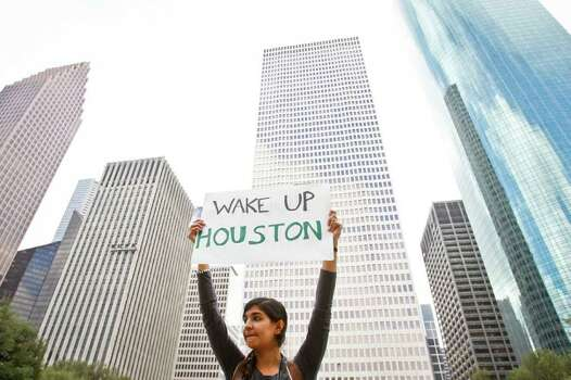 Hiba Siddiqui holds a sign as she and other protestors with the Occupy Houston movement, an outgrowth of the Occupy Wall Street protests in New York, gather at City Hall in downtown Houston to denounce what they describe as social and economic equality and corporate greed, Thursday, Oct. 6, 2011, in Houston. Photo: Michael Paulsen, Houston Chronicle / © 2011 Houston Chronicle
