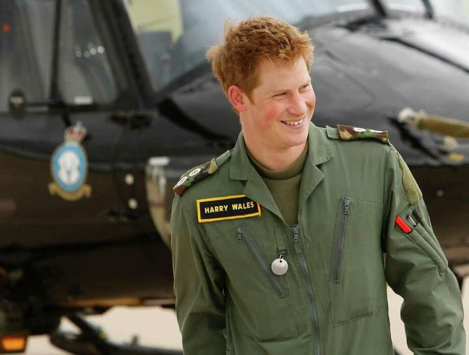 "ASSOCIATED PRESS NO BEGINNER: The prince wore a flight suit labeled ""Harry Wales"" during Royal Air Force training in 2009. Photo: Kirsty Wigglesworth / AP"