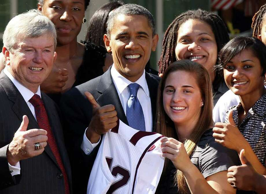 U.S. President Barack Obama  poses for a group picture with head coach Gary Blair and other team members during a Rose Garden event to welcome the Texas A&M University Women's Basketball Team to the White House October 6, 2011 in Washington, DC. President Obama hosted the basketball team to honor their 2011 NCAA Championship. Photo: Alex Wong, Getty / 2011 Getty Images