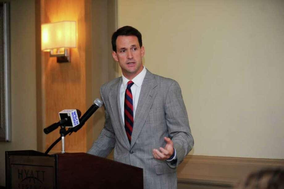 Rep. Jim Himes, D-Conn., speaks at the Greenwich Chamber of Commerce at the Update from Washington luncheon at Hyatt Regency Greenwich,Tuesday, Sept. 27, 2011. Photo: Helen Neafsey / Greenwich Time