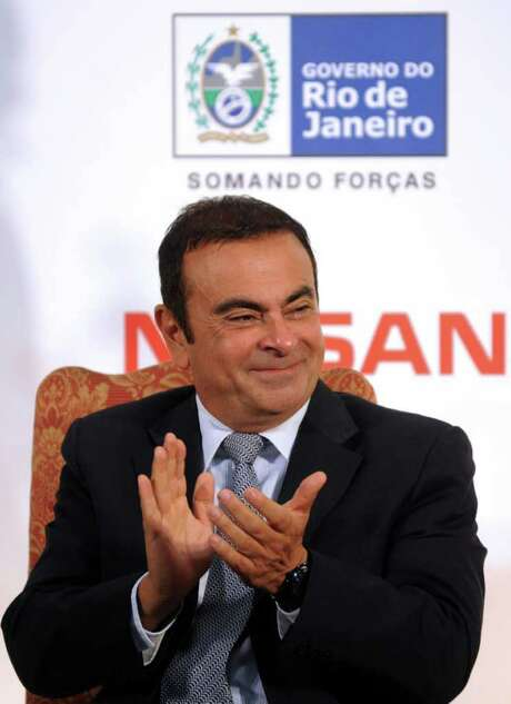 Nissan/Renault President Carlos Ghosn applauds on October 06, 2011 during a ceremony to launch a new Nissan plant at Guanabara palace in Brazil. Nissan aims to launch 10 new models in Brazil between now and 2016 and boost its sales network from 117 dealerships to 239. The investment will lead to creation of some 2,000 jobs, Nissan said.   AFP  PHOTO ANTONIO SCORZA (Photo credit should read ANTONIO SCORZA/AFP/Getty Images) Photo: ANTONIO SCORZA / AFP