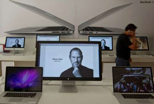 Christian Palma : Associated Press THE ART OF THE NEW: A computer screen displays a picture of Apple co-founder Steve Jobs at an Apple store in Mexico City. Apple products have shaped art forms, affecting the look, feel and sounds of the modern age. Photo: Christian Palma / AP