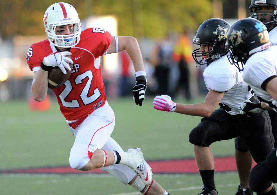 Fairfield Prep's Charles Keady sidesteps a pack of Jonathan Law defenders during their game Thursday Oct. 6, 2011 at Alumni Field at Fairfield University. Photo: Autumn Driscoll