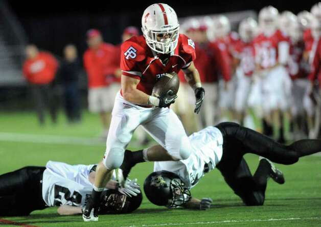 Fairfield Prep's Shane Dempsey avoids a takedown from Jonathan Law's Timmy Speer, left, and Connor Falaguerra during their game Thursday Oct. 6, 2011 at Alumni Field at Fairfield University. Photo: Autumn Driscoll