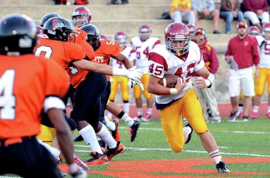 St. Joseph's Mike Pulaski (45) carries the ball for yardage during the football game against Stamford at Boyle Stadium at Stamford High School on Thursday, Oct. 6, 2011. Photo: Amy Mortensen / Connecticut Post Freelance