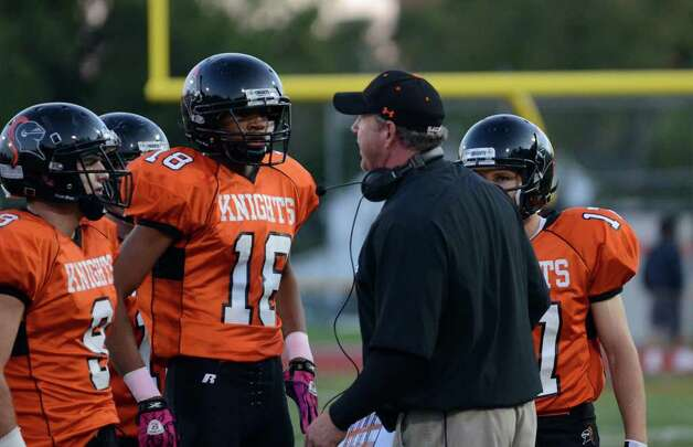 Stamford head football coach Bryan Hocter speaks to player Sean Padilla (18) during the football game against St. Joseph at Boyle Stadium at Stamford High School on Thursday, Oct. 6, 2011. Photo: Amy Mortensen / Connecticut Post Freelance