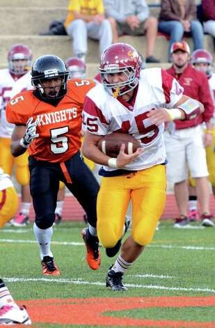 St. Joseph's Mike Pulaski (45) carries the ball for yardage as Stamford's Tarek Bruce (5) defends during the football game at Boyle Stadium at Stamford High School on Thursday, Oct. 6, 2011. Photo: Amy Mortensen / Connecticut Post Freelance