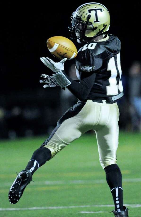 Receiver Mike Williams of Trumbull High School, # 10, catches a second quarter pass for a touchdown during High school football game between Greenwich High School and Trumbull High School at Trumbull High School, Thursday night, Oct. 6, 2011. Photo: Bob Luckey / Greenwich Time