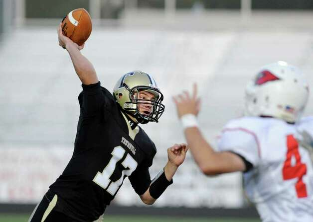 Trumbull High School QB Nick Roberts, # 17, throws during football game between Greenwich High School and Trumbull High School at Trumbull High School, Thursday night, Oct. 6, 2011. Photo: Bob Luckey / Greenwich Time