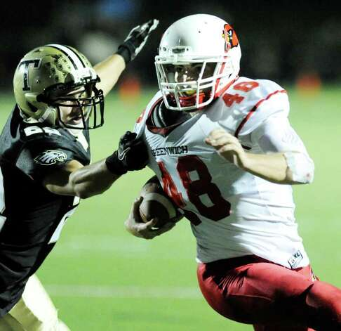 Running back Shane Nastahowski, right, # 48 of Greenwich High School, beats a Trumbull High School defender to score a 2nd quarter touchdown during high school football game between Greenwich High School and Trumbull High School at Trumbull High School, Thursday night, Oct. 6, 2011. Photo: Bob Luckey / Greenwich Time
