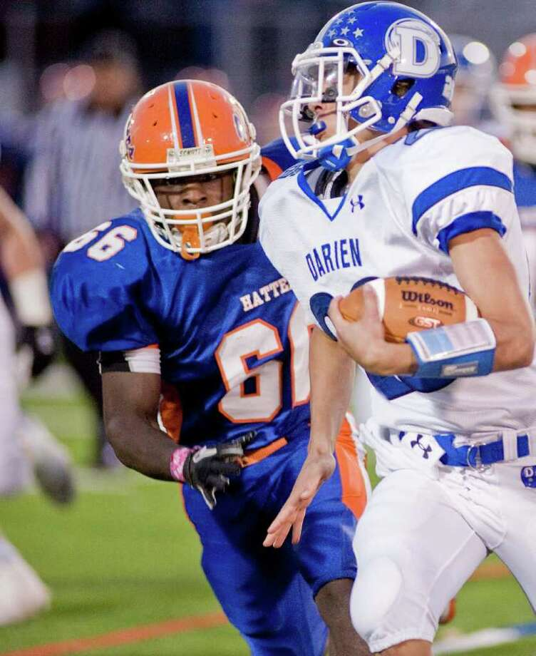 Danbury High School's Wesley Spears tries to chase down Darien High School's Peter Gesualdi during a football game at Danbury High School. Thursday, Oct. 6, 2011 Photo: Scott Mullin