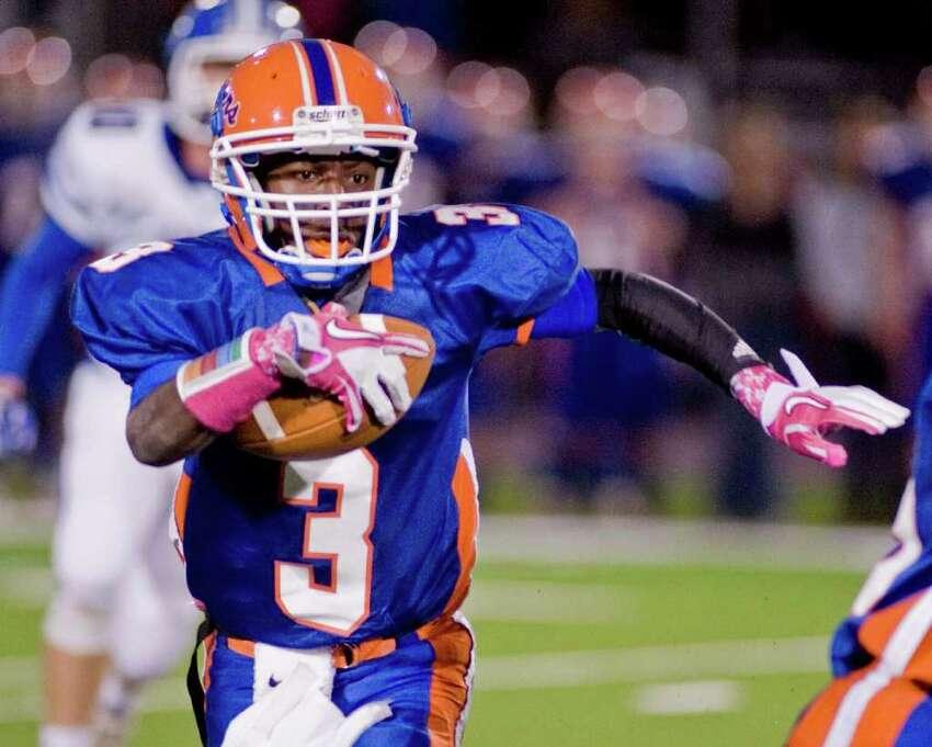 Danbury High School runner James Harrington carries the ball in a football game against Darien High School, at Danbury. Thursday, Oct. 6, 2011
