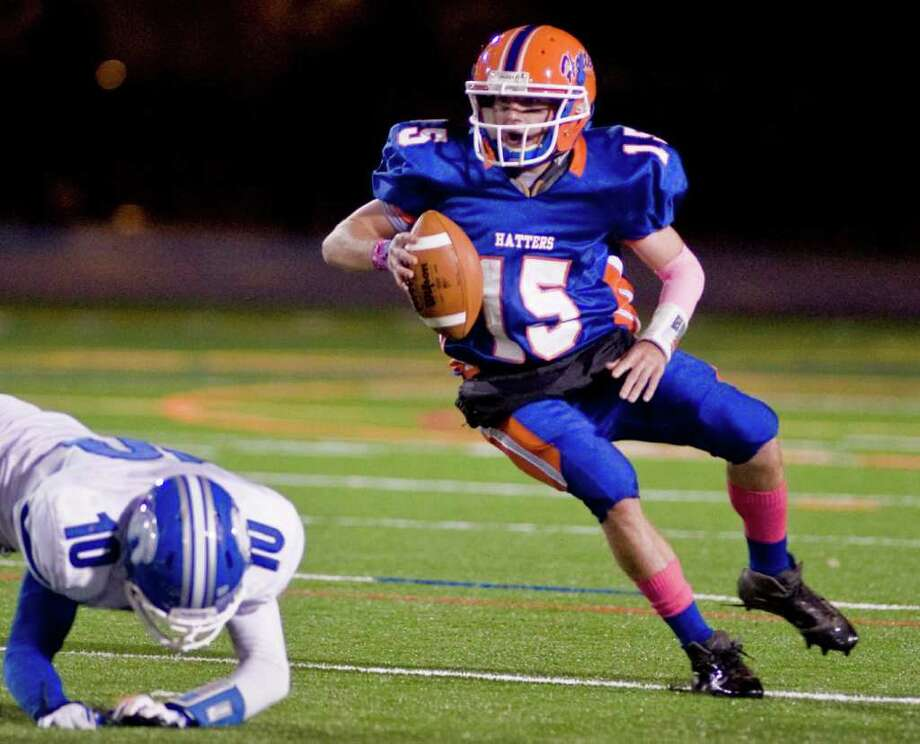 Danbury High School quarterback Garin Mooney looks for running room during a football game against Darien High School, at Danbury. Thursday, Oct. 6, 2011 Photo: Scott Mullin / The News-Times Freelance