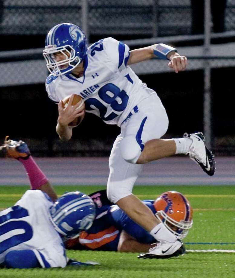 Darien High School's Ian Vanderhorn treis to maintain his balance running the football against Danbury High School during a game at Danbury. Thursday, Oct. 6, 2011 Photo: Scott Mullin / The News-Times Freelance