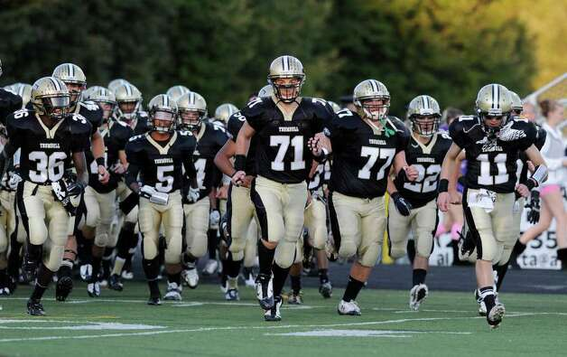 Grant Roman, # 71 of Trumbull High School, leads his team onto the field of play during High school football game between Greenwich High School and Trumbull High School at Trumbull High School, Thursday night, Oct. 6, 2011. Photo: Bob Luckey / Greenwich Time