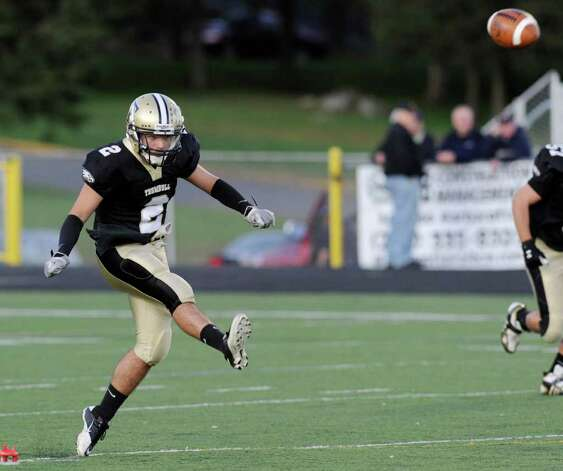 Rob Christiani, # 2, of Trumbull High School, kicks-off during high school football game between Greenwich High School and Trumbull High School at Trumbull High School, Thursday night, Oct. 6, 2011. Photo: Bob Luckey / Greenwich Time