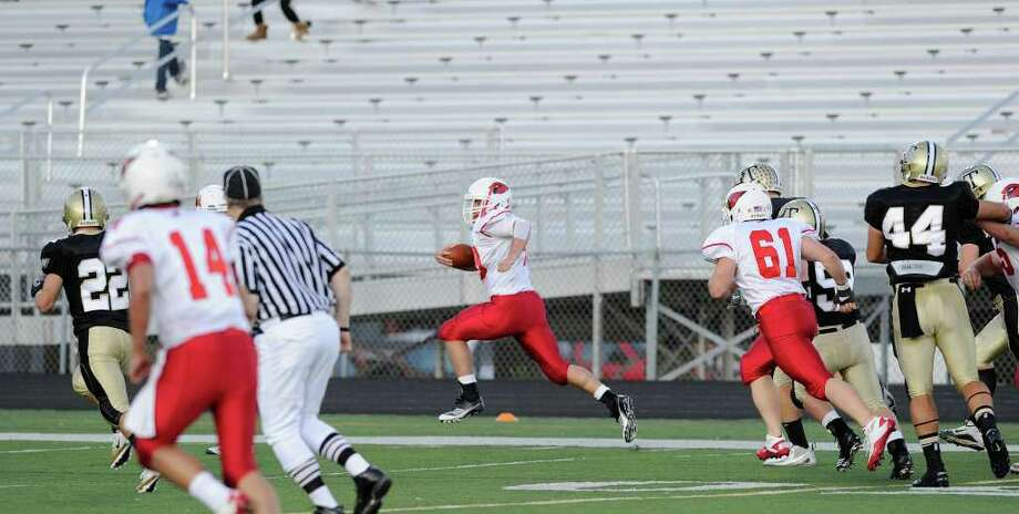 At center, Shane Nastahowski, # 48 of Greenwich High School, scores a touchdown on a first quarter run during high school football game between Greenwich High School and Trumbull High School at Trumbull High School, Thursday night, Oct. 6, 2011. Photo: Bob Luckey / Greenwich Time
