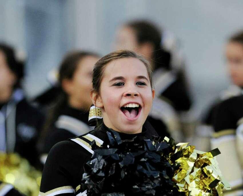 A Trumbull High School cheerleader in action during high school football game between Greenwich High School and Trumbull High School at Trumbull High School, Thursday night, Oct. 6, 2011.